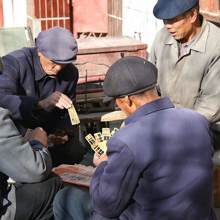 Chinese men playing cards