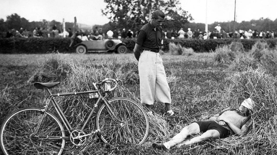 French pro cyclist having a power nap in the 1934 Tour