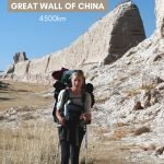 Katie L'Herpiniere walking next to the Great Wall of China