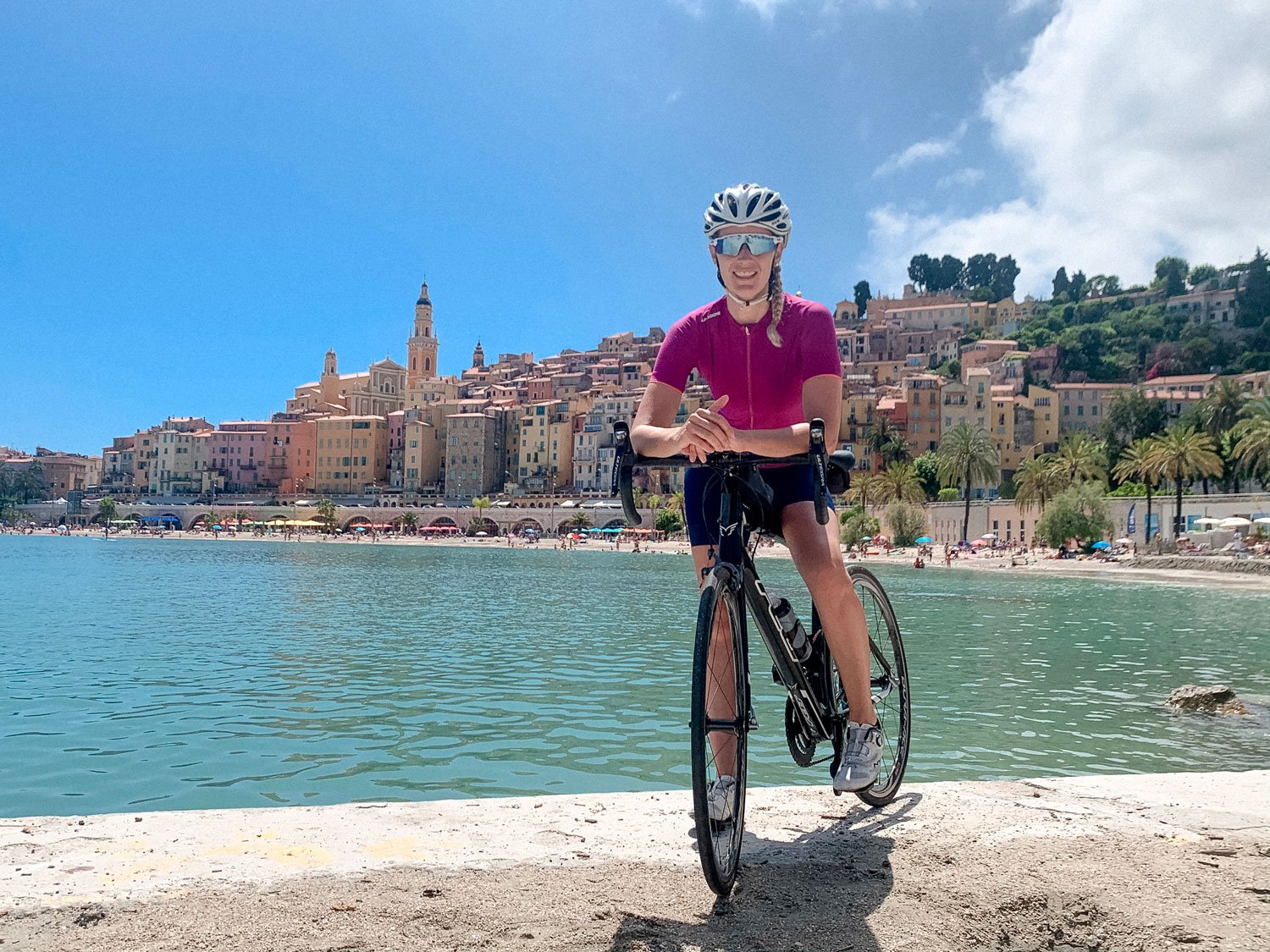 Girl cycling in Menton
