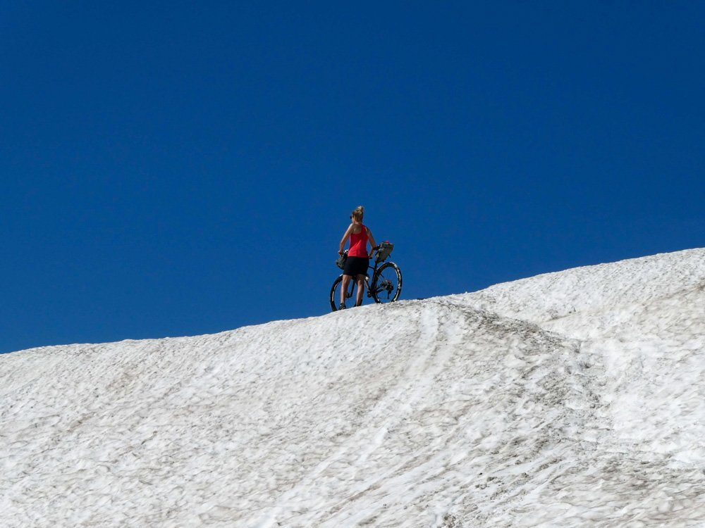 Pushing a mountain bike over the snow