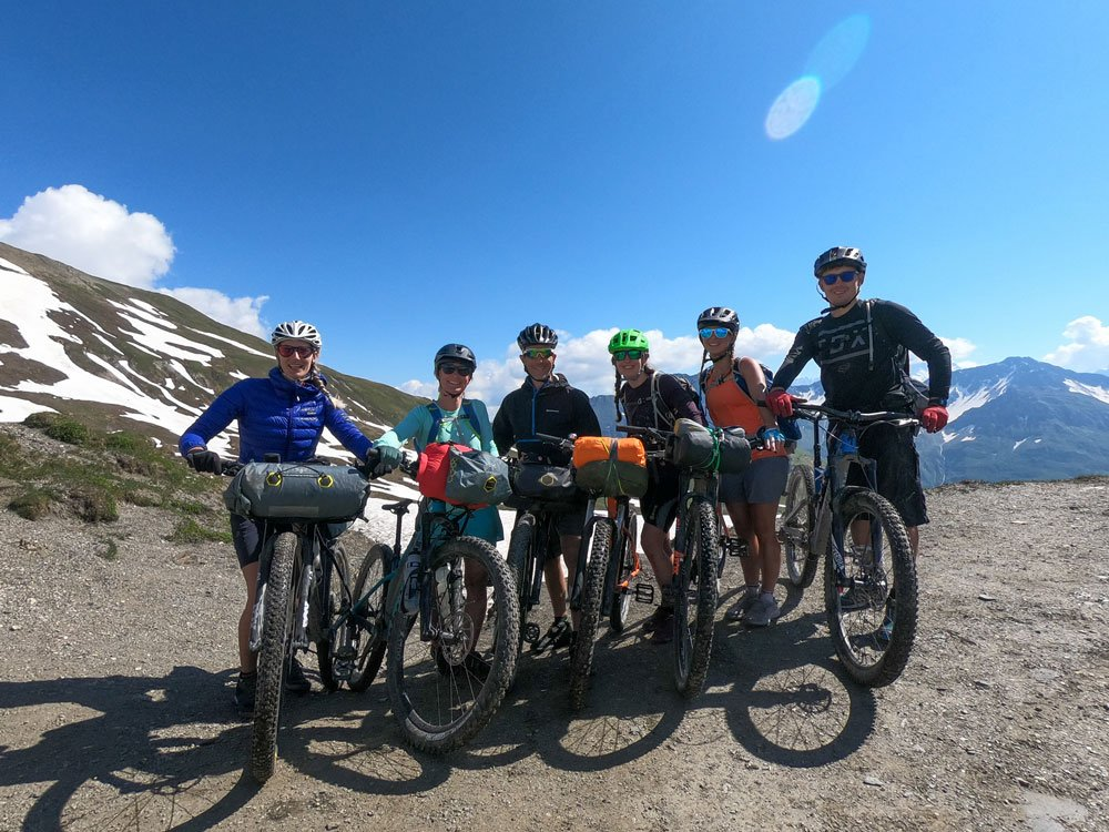 Group of 6 cyclists on top of the mountain