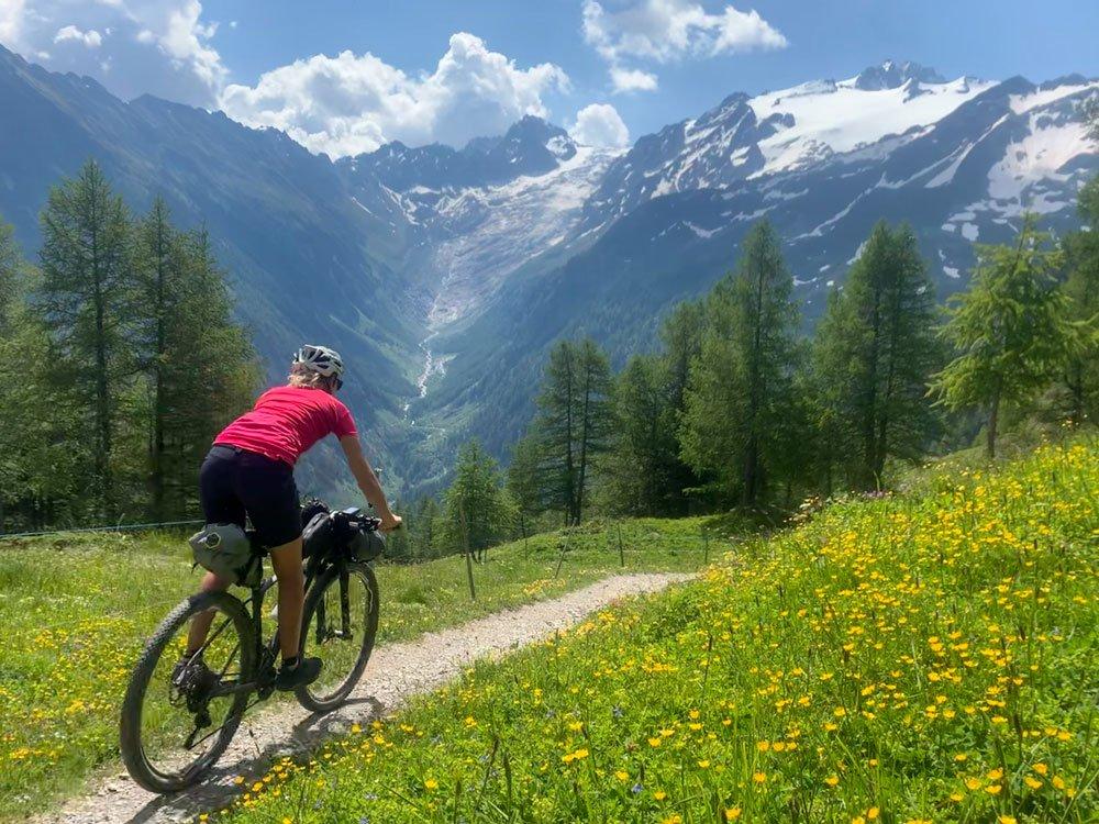 Girl descending on a mountain bike