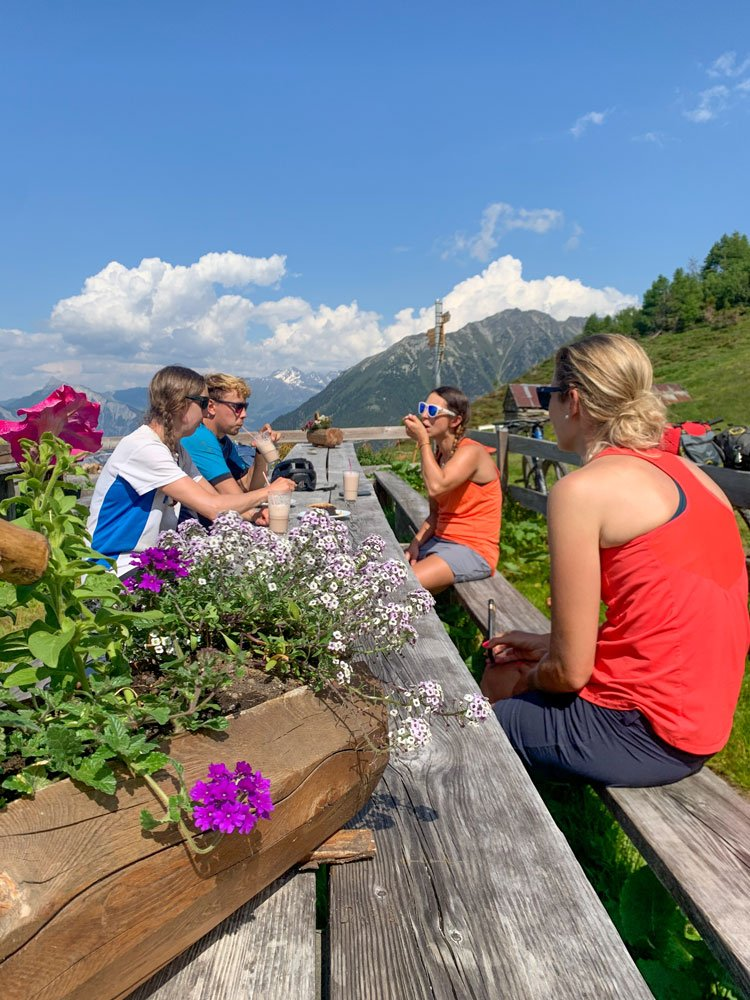 Group of people eating cake at a mountain refuge