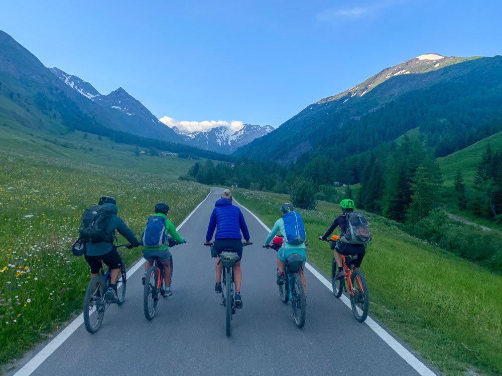 group of cyclists cycling up the road